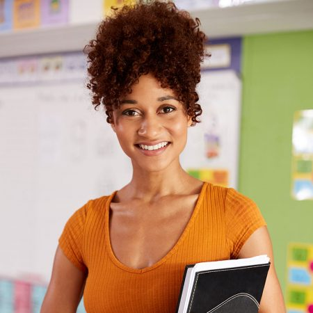 portrait-of-female-elementary-school-teacher-stand-5ECDT7K.jpg